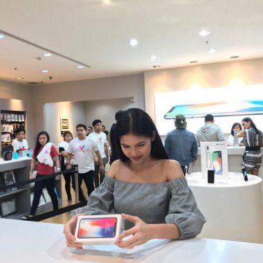 Customer enjoying her iPhone
