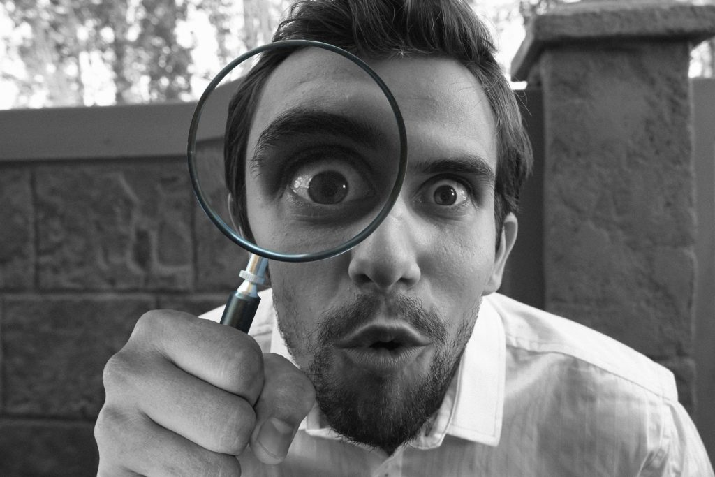 Man holding a magnifying glass